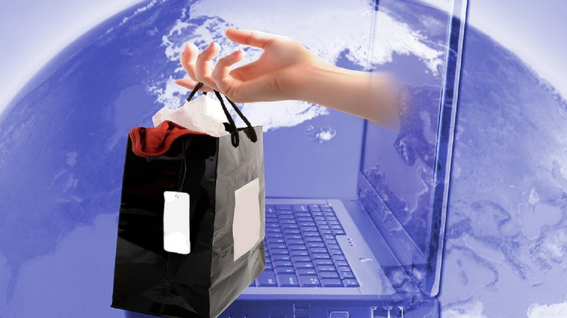 retail shopping bag coming out of computer with world in background for buy online pickup in store BOPIS